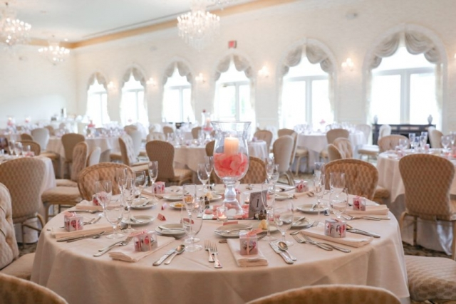 The wedding reception decor is kept bright and light for this couple
